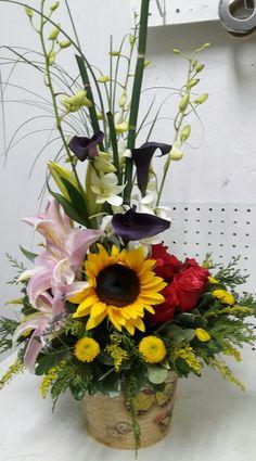Primaveral Lirios, orquideas, rosas y girasol