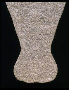 Stomacher    Place of origin:  England, Great Britain (made)    Date:  1730-1750 (made)    Artist/Maker:  unknown (production)    Materials and Techniques:  Linen, linen thread, silk thread, hand-sewn and hand embroidered    Credit Line:  Given by Mrs Lewis Day    Museum number:  T.209-1929