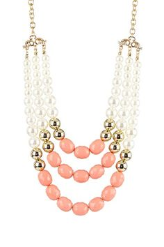 Bead layered bib necklace.