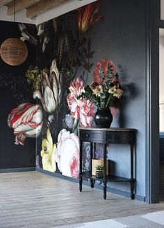 Bold floral wall mural on black background - dark and moody florals and unusual wallpaper are two of our top interior design trends of Read our feature for more ideas. Of Wallpaper, Beautiful Wallpaper, Flower Wallpaper, Large Floral Wallpaper, Botanical Wallpaper, Wallpaper Designs, Interior Design Wallpaper, Where To Buy Wallpaper, Tapestry Wallpaper