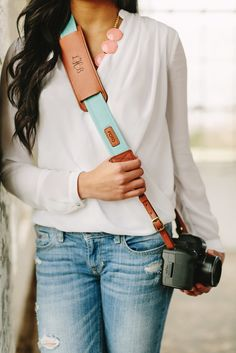 The Seaside Fotostrap - a stylish turquoise canvas and leather camera strap!  All Fotostraps are made in the USA, 10% of proceeds are donated to Fotolanthropy, and offer custom monogramming to the leather shoulder pad.  Add your name, initials, monogram, or even a business logo!  Shop at www.fotostrap.com.