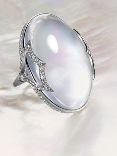 Ivanka Trump Large Rock Crystal Cabochon Cocktail Ring in Pave Diamond Pagoda Mounting. Available at London Jewelers.