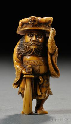 Ivory Netsuke, Japan, 19th century, carved in the shape of Shoki the Demon Queller, signed on back, lg. 2 1/2 in.