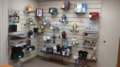 We did a little re-organizing recently - here is a good shot of our current merchandise wall. Cremation Services, Organizing, Organization, How To Plan, Wall, Home, Getting Organized, Organisation, Ad Home