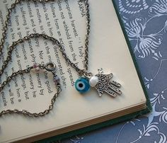 NEED and WANT this...evil eye and hamsa hand necklace...