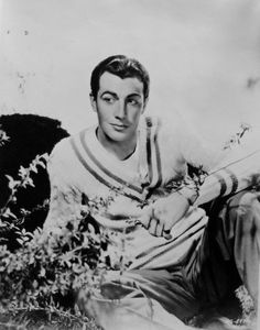 Actor Robert Taylor photographed in the 1930s wearing a sweater with a large v-neck. Typically sweaters were hand-knit.