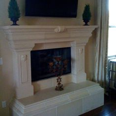 Audra's creme precast fireplace with raised hearth