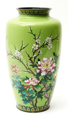 Vase with silver rims decorated with rose, tree-peony, plum blossom and chrysanthemums.