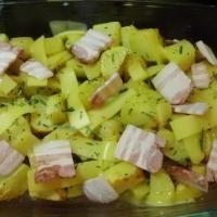 nun Rosmarin,Käse und Bacon drauflegen und unterm Grill im Backofen überbacken 5 Min.