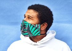 The DIOP Facemask -- Triple layered woven cloth mask made with our 100% wax printed cotton. Extra Fabric, Mask Making, Snug Fit, Printed Cotton, One Size Fits All, Red And Blue, Looks Great, Going Out, Wax
