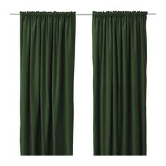 Dark green curtains blend with the current dark green carpet and reflect the curtains originally lining the bulkheads of the interior promenade.
