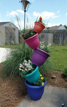 Create Your Garden Whimsy with These Tipsy Vertical Pot Planter [Picture Instructions] DIY Tipsy Vertical Pot Planter Projects & Instructions: Bucket, Container Gardening, Hanging Flower Pot, Flower Tower, Bath Tub Flower Tower Fountain and Garden Whimsy, Diy Garden, Garden Projects, Garden Pots, Shade Garden, Hanging Flower Pots, Flower Planters, Diy Planters, Planter Pots