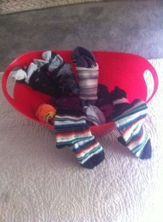 Sock bin used for standing tolerance, balance (using bilateral UE, not holding on to anything), weight shifting and functional reaching by placing the socks slightly out of their reach, endurance, also with wrist weights and then chuck each matched set into a small basket placed far from them. For each one that misses the basket the client has to go pick up with a reacher.