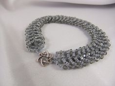 Handmade/Handwoven seed beads and Swarovski crystal bracelet with sterling silver toge clasp
