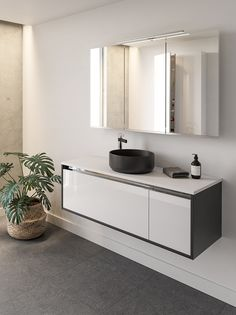 Two tone cabinets add great visual impact especially when combined with a stunning matt black basin and statement basin mixer.