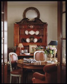 I like the idea of using McKay's mothers secretary in the dining area bump out and I also like the casual nature of using leather on the assortment of chairs around the table.