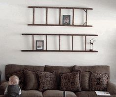 Ladder above couch or bed. Hold books or picture frames.