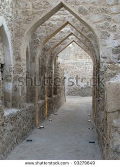 Bahrain, Portuguese Castle. A beautiful inner corridor with Arabic arches in Qal'at Bahrain- a UNESCO fortress that was Portuguese, from the Dilmun civilization & goes back to ancient Babylonia times.