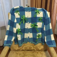 Talbots Tropical Print Sweater This Tropical-themed Sweater is perfect for those cool days.  The sweater is accented with palm tree motifs that are embellished with sequins and beads.  This preloved sweater, although hand wash, was dry cleaned after wear. Talbots Sweaters Cardigans