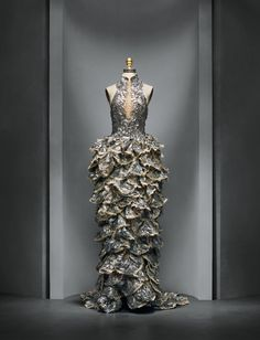 Alexander McQueen (British, founded 1992), Sarah Burton (British, born 1974). Ensemble, spring/summer 2012, Prêt–à–Porter. Machine–sewn white silk organza, hand–sewn to nude silk mesh; hand–embroidered with silver beads, clear crystals, and silver gelatin feather paillettes; hand–applique of silver silk and metallic hand–shredded petals, hand–embroidered with silver beads, clear crystals, and silver gelatin feather paillettes. Photo © Nicholas Alan Cope. #ManusxMachina #CostumeInstitute