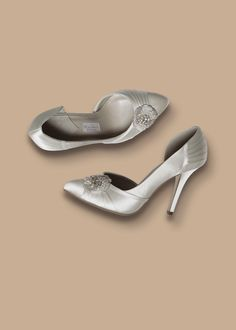 Sasso - This show stopping wedding shoe has a trendy short point finished in delicate silk satin pleats and a hand beaded motif with diamante and glass beads. The soft silky matte finish of the ivory silk satin makes this a very special wedding shoe. Stiletto Heels, High Heels, Ivory Silk, Silk Satin, Embellished Heels, Crystal Shoes, Bridal Stores, Court Shoes, Beautiful Shoes
