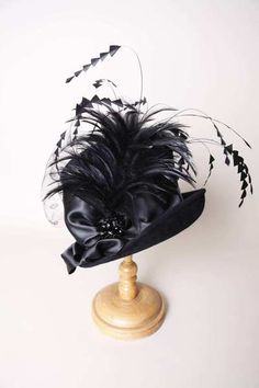 "The ""Kelly, black"" hat by Louise Green Millinery. This is one of the hats that is part of the fall-winter 2012 line."