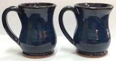A pair of rimmed coffee mugs. Wheel thrown by TraditionsPottery