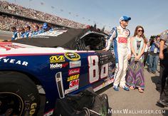 Dale Earnhardt Jr. and his girlfriend Amy Reimann stand next to Earnhardt's #88 National Guard Chevrolet prior to the start of the NASCAR Sprint Cup Series Budweiser Duel #1 at Daytona International Speedway in Daytona Beach, Florida February 21, 2013.