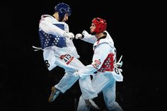Martin Stamper Photos Photos - Martin Stamper of Great Britain competes against Damir Fejzic of Serbia during the Men's -68kg Taekwondo quarterfinal match on Day 13 of the London 2012 Olympic Games at ExCeL on August 9, 2012 in London, England. - Olympics Day 13 - Taekwondo