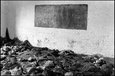 RWANDA. 1994. Tutsi corpses litter the floor of a classroom at a parish in Nyarubuye. More than 1000 people were killed here by civilian Hutu militia.