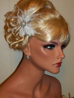 White feather bridal fascinator with pearl/rhinestone center