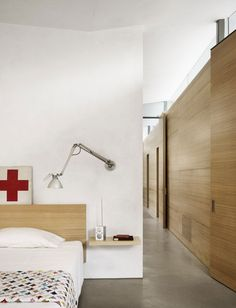 headboard, wooden wall, white room