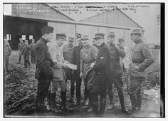 1. K. Rockwell, 2. Capt. Thenault, 3. Norman Prince, 4. Lieut. DeLaage, 5. Sgt. E, Cowdin, 6. Sgt. Bert Hall, 7. J.R. McConnell, and 8. Victor Chapman (LOC)