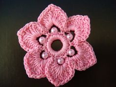 a peace of crocheted and beaded flower