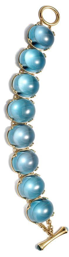 Large Blue Topaz Oval Cabochon Bracelet in 18kt Gold-----------For more Information Call Us At: (727) 586-2577 Or Visit: www.haroldfreemanjewelers.com   www.youtube.com/watch?v=dXT8vy4e8c4 www.facebook.com/HaroldFreemanJewelers