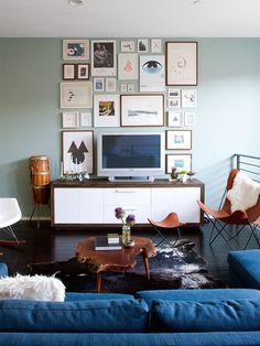 Like the navy sofa and aqua wall colour