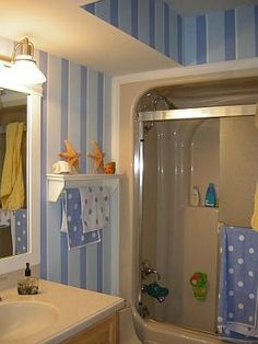 kids bathroom (looking at the stripes part)?  or it could be wider stripes and just two colors?  (this one looks like it also has a tiny white stripe)