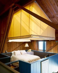 "#RoomOfTheDay: The open bedroom in architect #CharlesMoore's home Condominium 1, Unit 9 — part of the Sea Ranch development in California. Suspended above part of the home's living room, the sleeping loft is surrounded by a canvas tent covering that can be lowered for privacy. ""Moore once said that the best way to understand a building is to be able to take a nap in it,"" writes @LeslieWilliamson, the author and photographer of the book ""Interior Portraits: At Home With Cultural Pioneers and…"