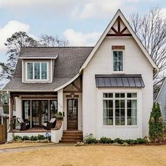 This cottage home exudes perfect curb appeal! This cottage home exudes perfect curb appeal! Dream House Exterior, Cottage Home Exteriors, Cottage Exterior, Small Cottage Homes, Cottage Style House Plans, Rustic Exterior, Exterior Signage, Modern Farmhouse Exterior, Cottage Style Homes
