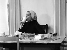 Edie enjoys the King of Beers from a styrofoam cup and a little paté in this 1978 or 1979 Frank Battaglia photo, taken in Grey Gardens dining room.