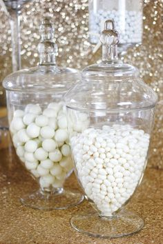 Check out this Look for Less Beach Bride candy buffet and dessert table with sparkly gold sequin and all white candy and custom desserts.