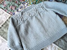 Knitionary: baby owlet sweater and a baby quilt