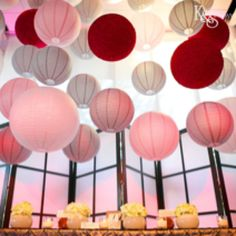 AUTUMN - When using a few different shades of round paper lanterns try choosing one bolder colour to add definition created here by stunning red hanging lanterns.