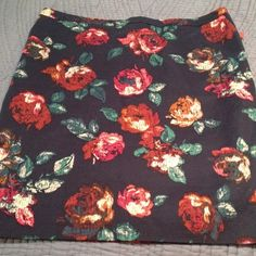 Merona floral skirt size 18 NWT Re-posh. Sold to me as a 16 and I didn't realize it was an 18 until after I accepted....also the tag has been ripped in half and there is a black mark in the manufacturers tag. Reasonable offers will be considered. Bundle to save! Merona Skirts