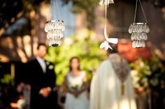 The trees were draped with strands of satin ribbons and white cymbidium orchids, and accented with elegant crystal chandeliers from Z Gallerie.
