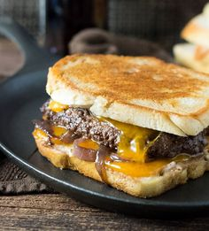 INGREDIENTS: 1½ pounds ground beef 2 teaspoons Worcestershire sauce 1 teaspoon kosher salt ½ teaspoon ground black pepper 12 slices sourdough bread ½ cup Secret Sauce 3 medium Vidalia onions, thinly sliced 6 slices Cheddar cheese 8 tablespoons unsalted butter Secret Sauce: ¼ cup Dijon mustard ¼