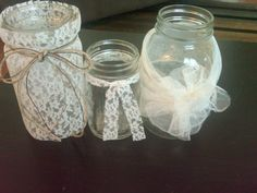 DIY centerpiece ideas. Use different size mason jars and delicate fabrics like lace and tulle. Easy to make and put tea lights or short candles in the bottom for a glowing lace effect. Beautiful!