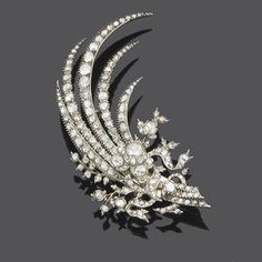 A late 18th century diamond aigrette, circa 1790  The central rose-cut diamond flowerhead cluster to a spray of rose-cut diamond leaves, within closed-back settings, later brooch fitting,