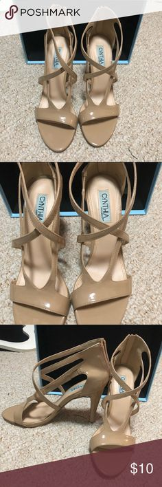 Cynthia Rowley Nude Strappy Heel Super cute heels! The Cynthia Rowley's are nude in color, with a 3 1/2 inch heel. They have not been worn but a few times. They are very nice shoes! It is a nude patent leather with a zippered back. Cynthia Rowley Shoes Heels