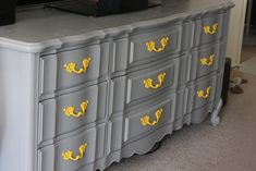 love the grey dresser, handles would be cuter in a softer yellow (or use colors on other furniture in the bedroom)